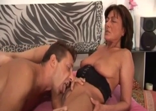 Brunette mommy blows him real nice