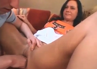 Brunette fucked with a huge toy here