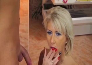 Blonde riding a fat cock on the floor