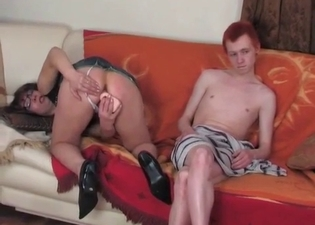 Mommy fucks herself with a toy for him