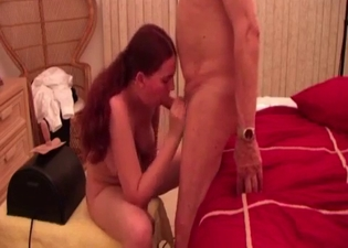 Redheaded girl sucks on dad's cock