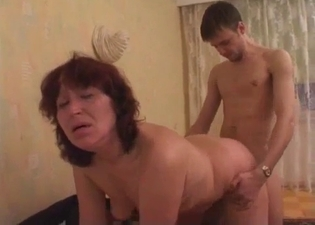 Mommy rides him after rubbing her tits